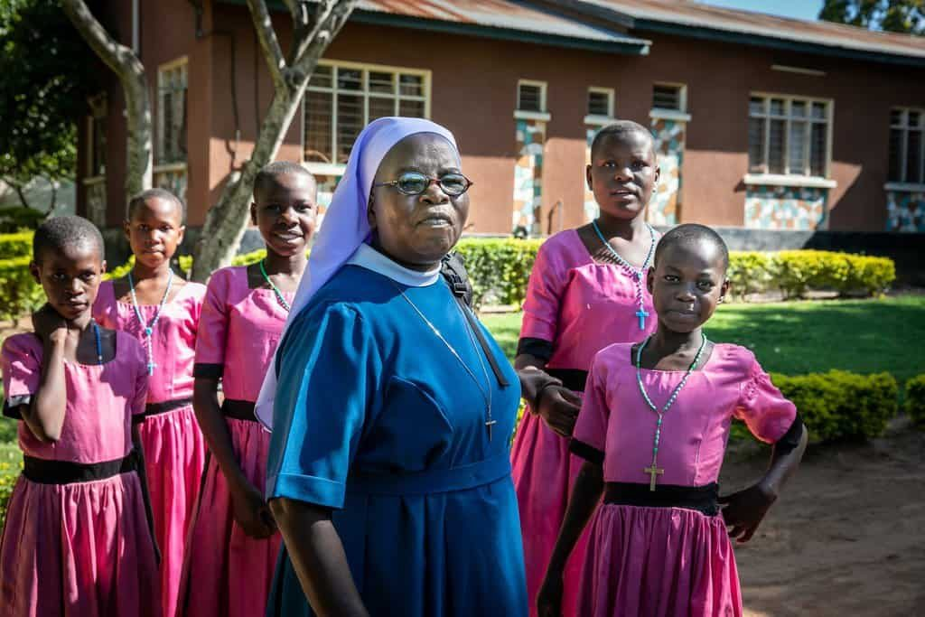 Sister Annunciata Chacha, a member of the Immaculate Heart Sisters of Africa, poses with girls from the Jipe Moyo shelter in Musoma, Tanzania. (CNS photo/Jerry Fleury, Maryknoll Lay Missioners)