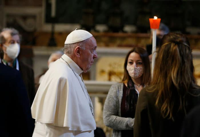Young people carry candles in procession as Pope Francis arrives to pray the rosary with a small number of the faithful in St. Peter's Basilica at the Vatican May 1, 2021. The pope began a monthlong rosary marathon praying for an end to the COVID-19 pandemic. (CNS photo/Paul Haring)