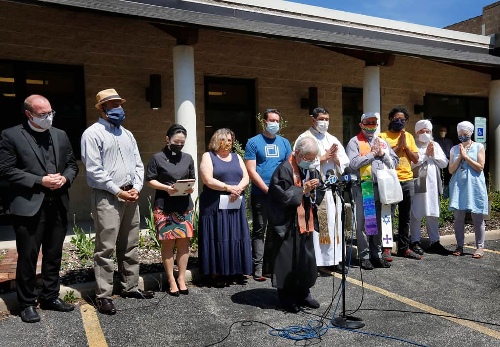 stop AAPI hate- Rev. Patti Nakai of the Buddhist Temple of Chicago leads a prayer during an interfaith rally against racism toward Asian Americans and Pacific Islanders May 2, 2021. (CNS photo/Karen Callaway, Chicago Catholic)