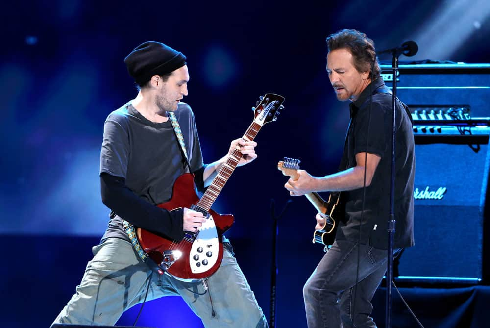 """In this image released May 2, 2021, Josh Klinghoffer and Eddie Vedder perform onstage during Global Citizen """"Vax Live: The Concert To Reunite The World,"""" at SoFi Stadium in Inglewood, Calif. The concert was broadcast May 8 and included messages from Pope Francis and U.S. President Joe Biden. (CNS photo/Kevin Winter/Getty Images for Global Citizen VAX LIVE)"""