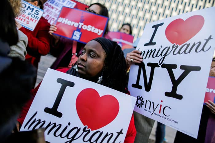 reprieve for Haitians: Haitian immigrants and supporters in New York City hold placards in support of Temporary Protected Status in this 2017 file photo. On May 22, 2021, the Biden administration granted eligible Haitian nationals living in the United States the chance to apply for a new 18-month TPS designation. (CNS photo/Eduardo Munoz, Reuters)
