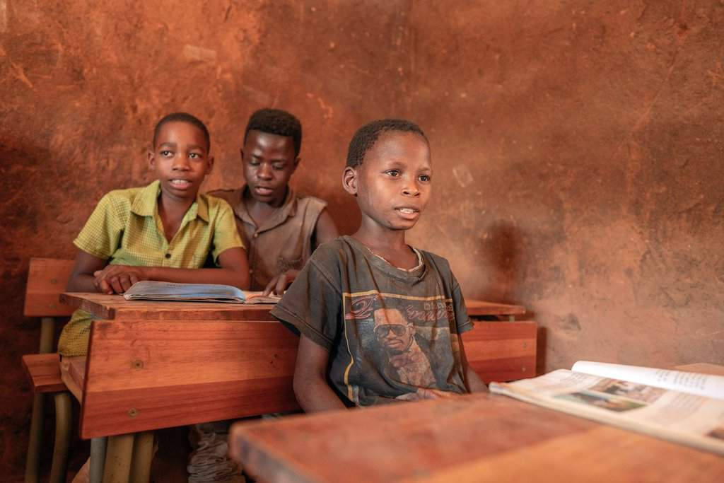 Displaced boys participate in school work in a camp in Mozambique's Cabo Delgado province in this 2019 photo. Residents in northern Mozambique, a region rich in natural gas deposits, have been grappling with an Islamist insurgency since 2017. (CNS photo/Alessandro Grassani, courtesy AVSI)