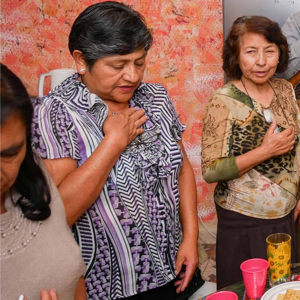 María Terrazas prays during a Small Christian Community meeting at Father Paul Masson's home. (Nile Sprague/Bolivia)