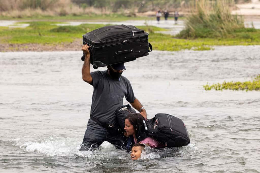 Migrants from Venezuela seeking asylum in the U.S. cross the Rio Grande into Del Rio, Texas, May 10, 2021. (CNS photo/James Breeden, Reuters)