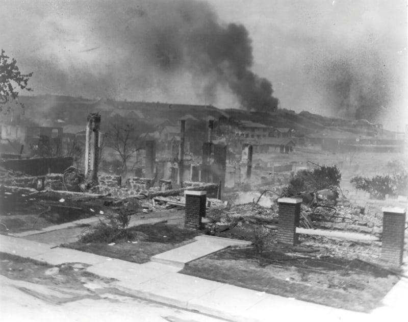 Smoke rises from the ruins of African Americans' homes following the 1921 race massacre in Tulsa, Okla. (CNS photo/Alvin C. Krupnick Co., National Association for the Advancement of Colored People Records, Library of Congress, Handout via Reuters)