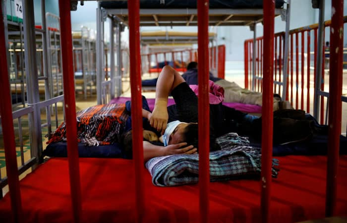 A migrant from Central America who was airlifted from Brownsville, Texas, to El Paso, Texas, and then deported with her son are seen at a temporary temporary shelter in Ciudad Juarez, Mexico, April 5, 2021. (CNS photo/Jose Luis Gonzalez, Reuters)