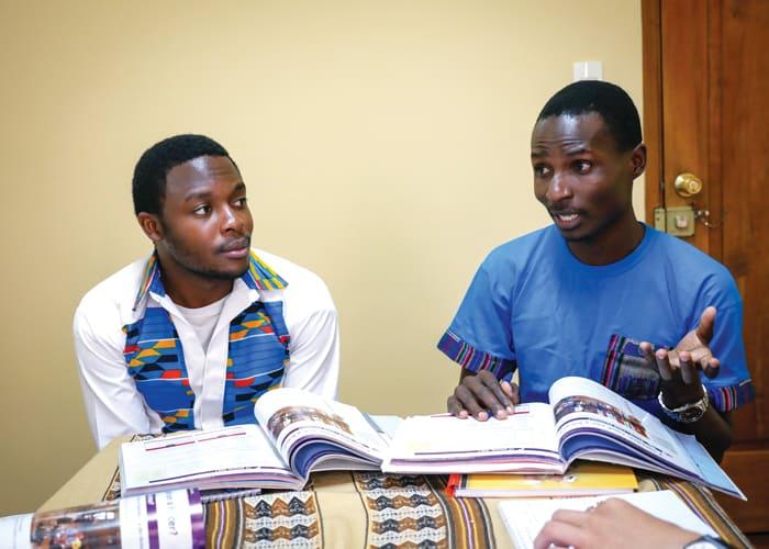 Maryknoll seminarians Joshua Mutende (white shirt) and Charles Ogony learn Spanish at the Maryknoll Mission Center in Cochabamba, Bolivia. (Nile Sprague/Bolivia)
