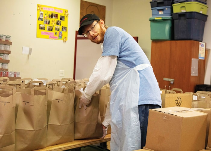 Before heading to his OTP in Bolivia, Maryknoll brother candidate Paul Shultz volunteered once a week at St. James Food Pantry in Chicago. (Octavio Duran/U.S.)