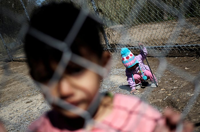Migrant minors seeking asylum in the U.S. are seen at a migrant encampment in Matamoros, Mexico, Feb. 19, 2021. (CNS photo/Daniel Becerril, Reuters)