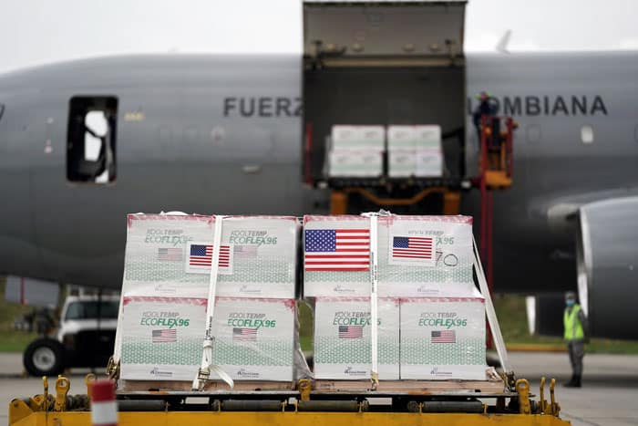 U.S. flags are taped on a shipment of Johnson & Johnson COVID-19 vaccines in Bogota, Colombia, July 1, 2021. (CNS photo/Nathalia Angarita, Reuters)