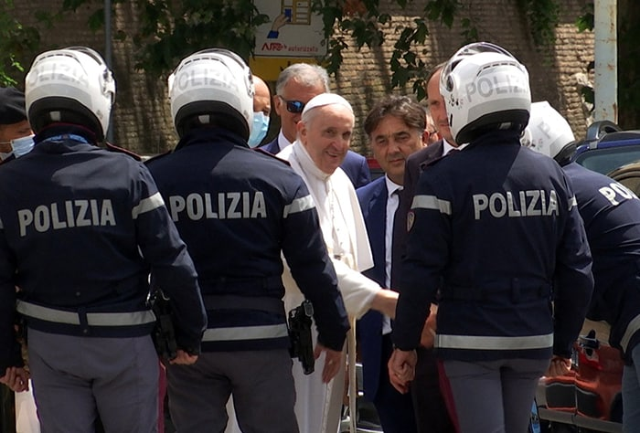 Pope Francis greets police officers before entering the Vatican after being discharged from Rome's Gemelli hospital following his recovery from colon surgery in this screengrab taken from a video July 14, 2021. (CNS photo/Cristiano Corvino, Reuters TV screengrab)