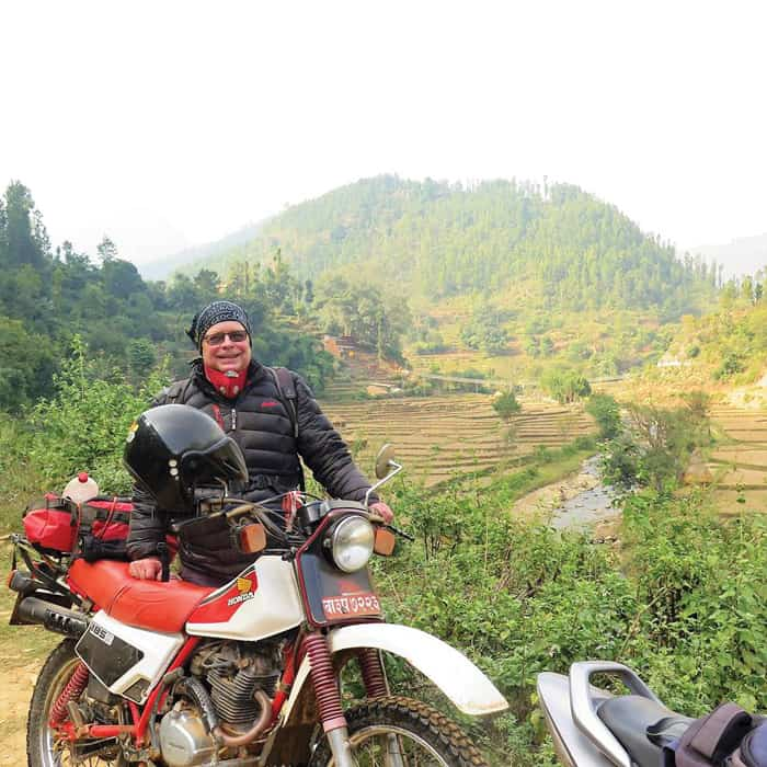 Maryknoll Father Joseph Thaler has logged thousands of miles over rough terrain on his 30-year-old Honda XL 185 motorcycle to visit the Nepalese. (Courtesy of Joseph Thaler/Nepal)