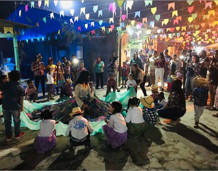 """Margarita Durán leads the traditional skirt dance for children during Community Haiti's """"Festa Junina"""" celebration of the feast of St. John the Baptist. (Oscar Britez/Brazil)"""