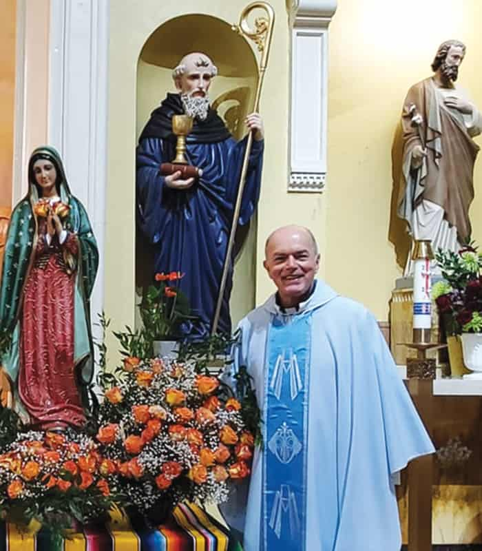 Father Lopez-Cardinale smiles during the feast of Our Lady of Guadalupe in December 2020 at his parish in Somerville, Massachusetts. (Courtesy St. Benedict parish/U.S.)