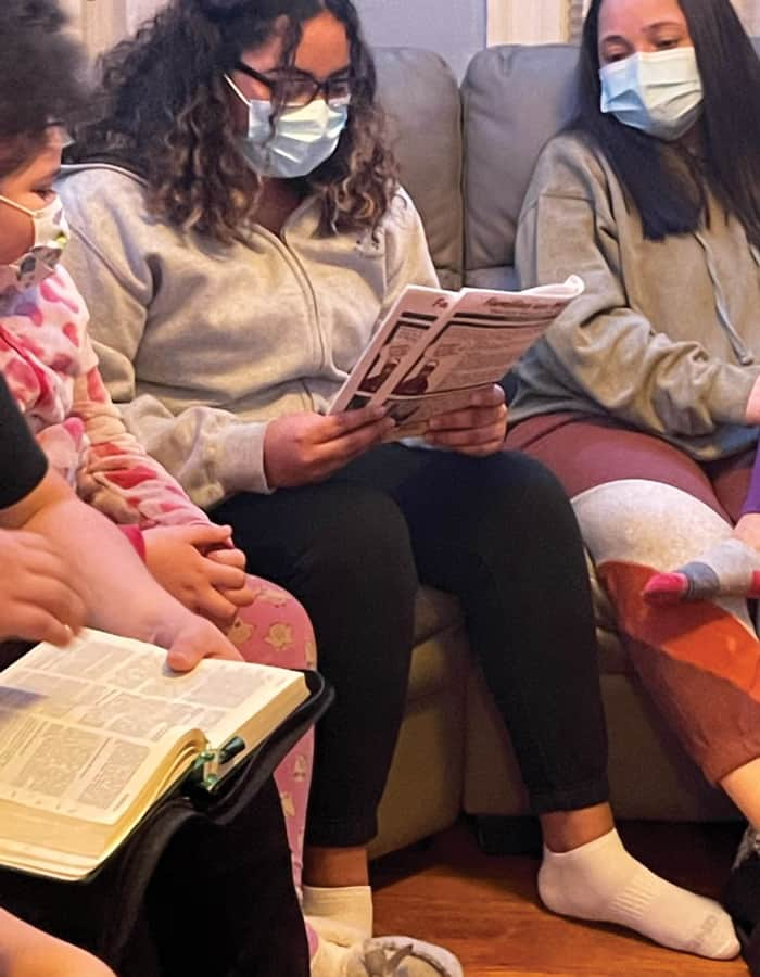 At a weekly prayer encounter during Lent of 2021, Kayla Lopez reads the Maryknoll study guide as other participants listen and reflect. (Courtesy of Alejandro Lopez-Cardinale/U.S.)