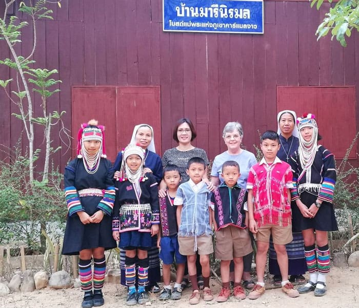 Along with a fellow Maryknoll volunteer (third from right), Doctor Anna Morris (back row, second from left) accompanies members of a local congregation, the Missionary Sisters of the Immaculate Conception, in their ministry to villagers of the Akha and Karen hill tribes in northern Thailand. (Courtesy of Anna Morris/Thailand)