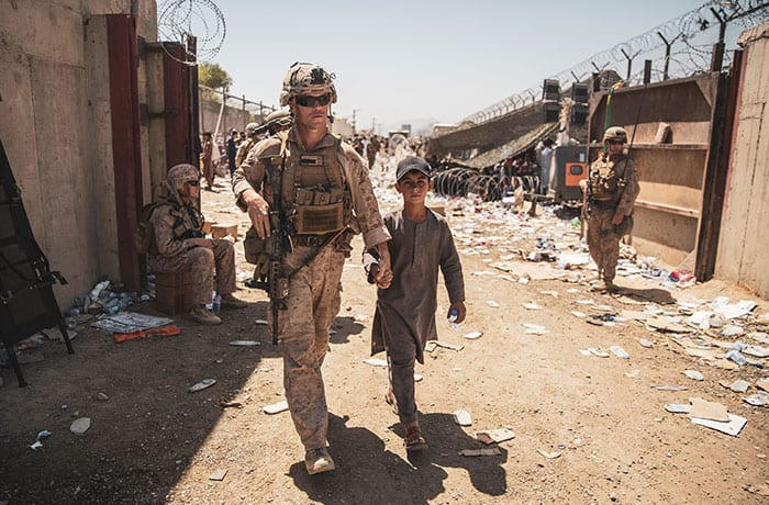Father Scalese and others flee Kabul - A U.S. Marine escorts a child to his family during an evacuation at Hamid Karzai International Airport in Kabul, Afghanistan, Aug. 24, 2021. (CNS photo/Sgt. Samuel Ruiz/U.S. Marine Corps/handout via Reuters)