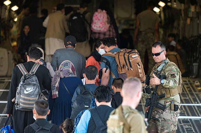 Father Scalese and others flee Afghanistan: U.S. Air Force members guide qualified evacuees aboard a C-17 Globemaster III at Hamid Karzai International Airport in Kabul, Afghanistan, Aug. 24, 2021. (CNS photo/U.S. Air Force/Senior Airman Taylor Crul/handout via Reuters)