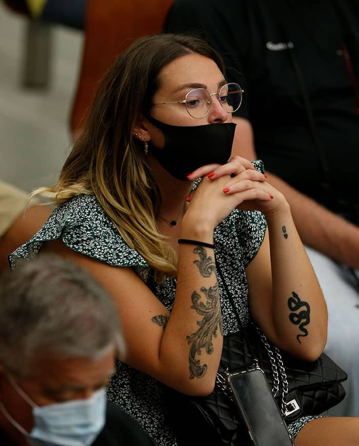 """A woman with tattoos on her arms attends Pope Francis' general audience in the Paul VI hall at the Vatican Sept. 8, 2021, where he said differences and conflicts caused by separation """"should not exist among believers in Christ."""" (CNS photo/Paul Haring)"""