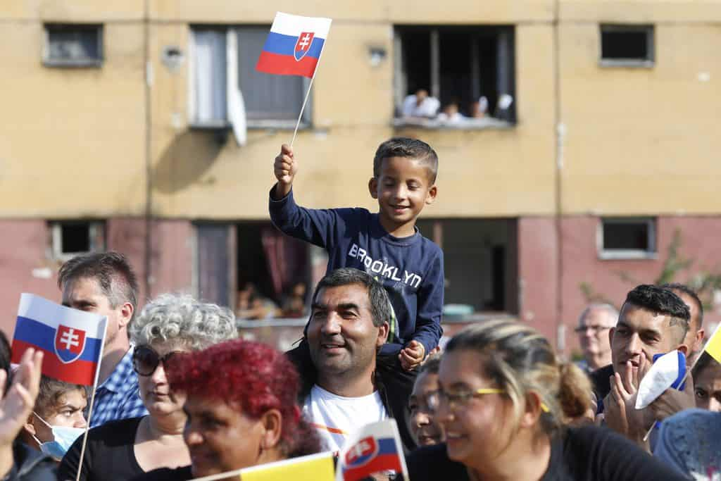 People wait for Pope Francis' arrival for a meeting with the Roma community in the Luník IX neighborhood in Košice, Slovakia, Sept. 14, 2021. After the visit to Hungary and Slovakia the pope spoke about communion on the papal plane. (CNS photo/Paul Haring)